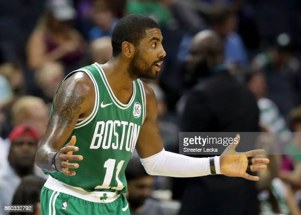Kyrie Irving of the Boston Celtics reacts against the Charlotte Hornets during their game at Spectrum Center on October 11 2017 in Charlotte North...