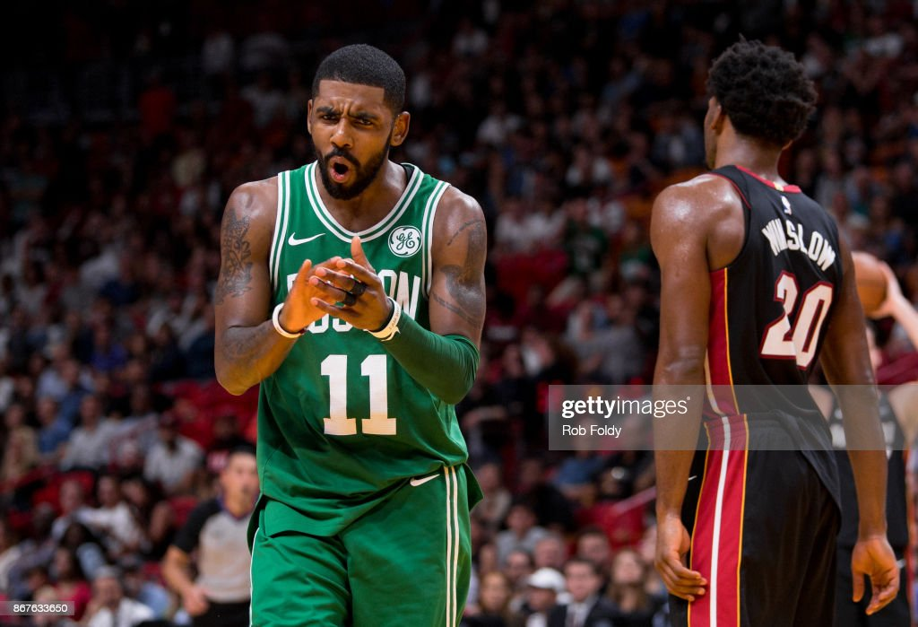 Kyrie Irving #11 of the Boston Celtics reacts during the second half of the game against the Miami Heat at the American Airlines Arena on October 28, 2017 in Miami, Florida.