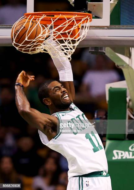 Kyrie Irving of the Boston Celtics scores against the Charlotte Hornets during the first half at TD Garden on October 2 2017 in Boston Massachusetts...
