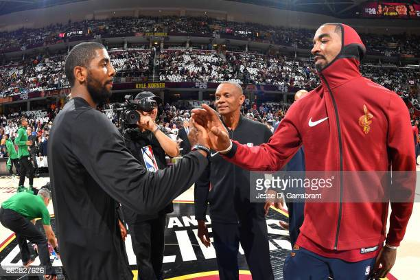 Kyrie Irving of the Boston Celtics shakes hands with JR Smith of the Cleveland Cavaliers before the game on October 17 2017 at Quicken Loans Arena in...