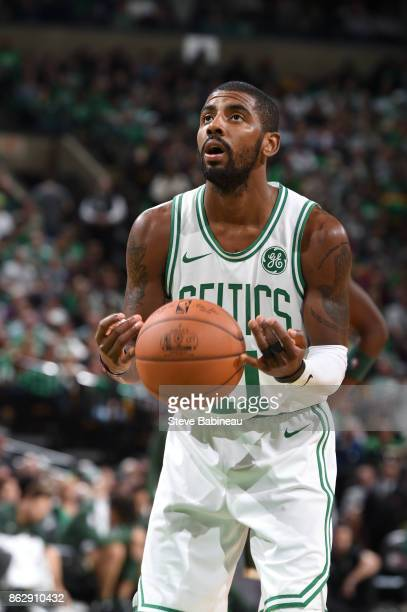 Kyrie Irving of the Boston Celtics shoots a free throw against the Milwaukee Bucks on October 18 2017 at the TD Garden in Boston Massachusetts NOTE...