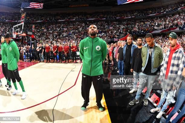 Kyrie Irving of the Boston Celtics stands on the court for the National Anthem before the game against the Cleveland Cavaliers on October 17 2017 at...