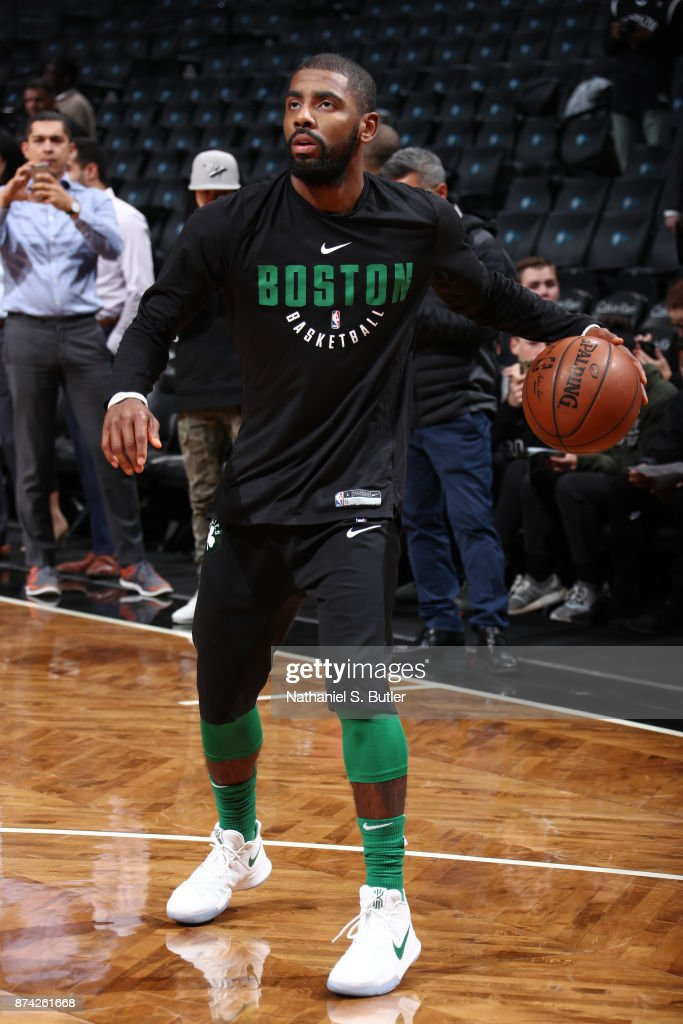 Kyrie Irving #11 of the Boston Celtics warms up before the game against the Brooklyn Nets on November 14, 2017 at Barclays Center in Brooklyn, New York.