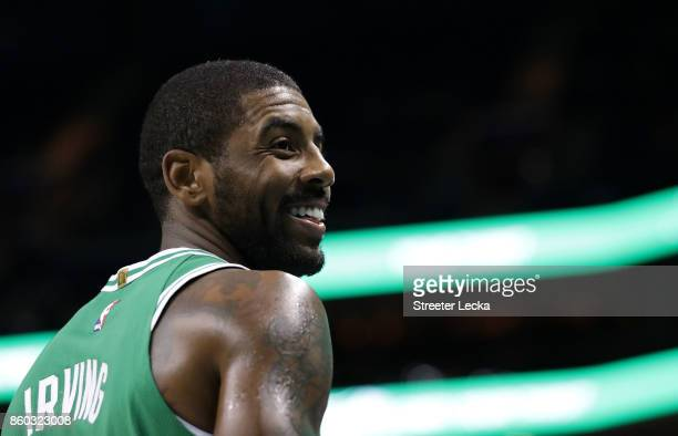 Kyrie Irving of the Boston Celtics watches on against the Charlotte Hornets during their game at Spectrum Center on October 11 2017 in Charlotte...