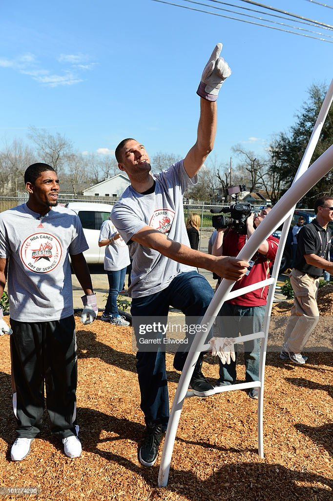 Kyrie Irving #2 of the Cleveland Cavaliers and Brook Lopez #11 of the Brooklyn Nets participate at the 2013 NBA Cares Day of Service at the Playground Build with KaBOOM! on February 15, 2013 in Houston, Texas.