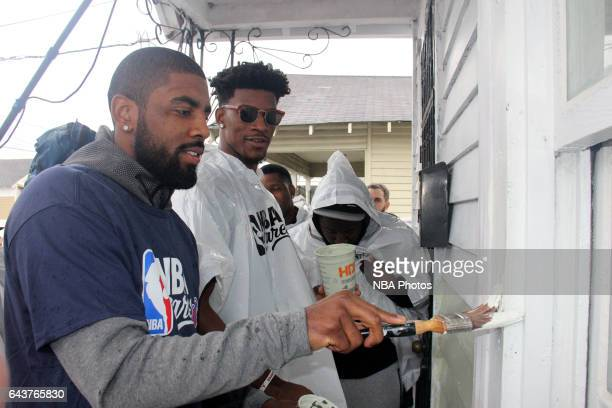 Kyrie Irving of the Cleveland Cavaliers and Jimmy Butler of the Chicago Bulls participates during the NBA Cares Day of Service as part of 2017...