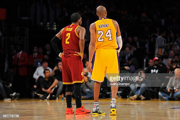 Kyrie Irving of the Cleveland Cavaliers and Kobe Bryant of the Los Angeles Lakers stand on the court during a game at STAPLES Center on January 15...