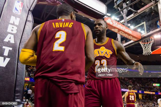 Kyrie Irving of the Cleveland Cavaliers and LeBron James celebrate after a play during the first half against the New York Knicks at Quicken Loans...