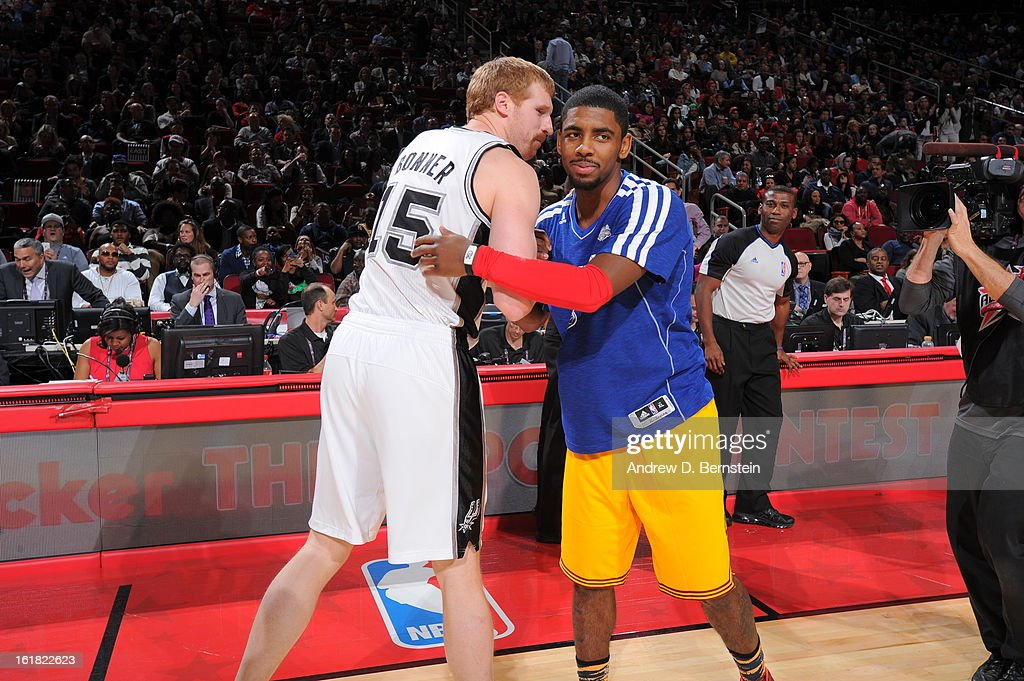 Kyrie Irving #2 of the Cleveland Cavaliers and Matt Bonner #15 of the San Antonio Spurs hug during the 2013 Foot Locker Three-Point Contest on State Farm All-Star Saturday Night as part of 2013 NBA All-Star Weekend on February 16, 2013 at Toyota Center in Houston, Texas.
