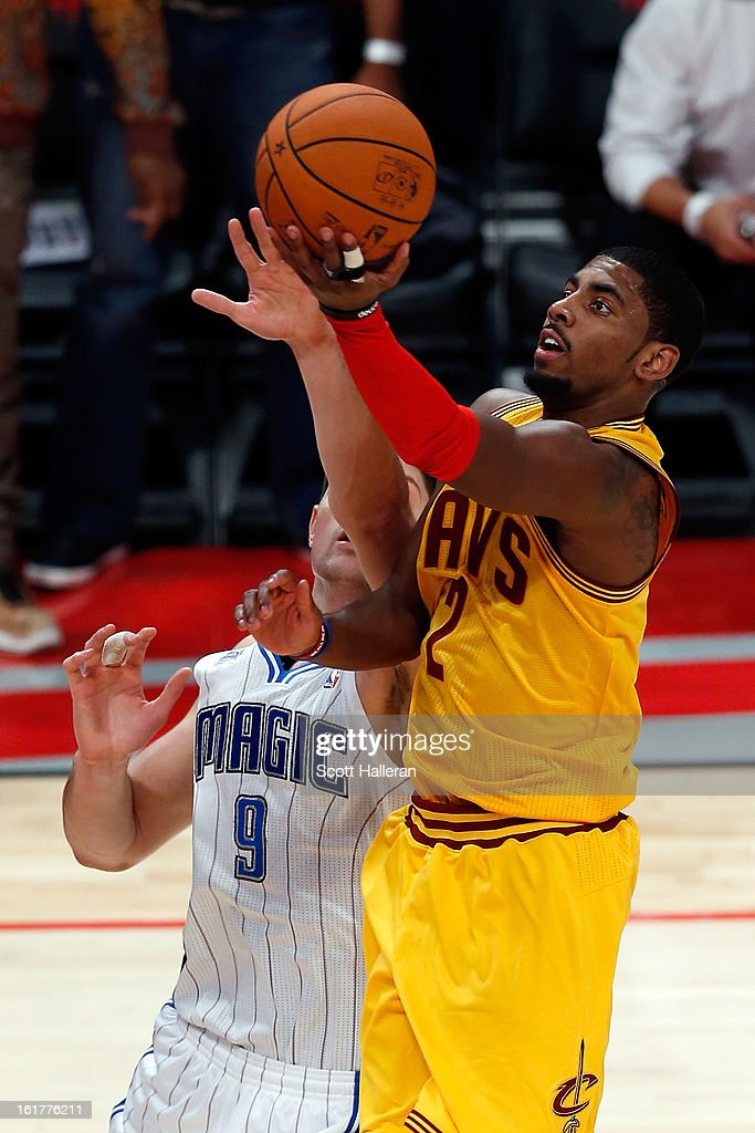 Kyrie Irving #2 of the Cleveland Cavaliers and Team Shaq goes up for a shot in the lane against Nikola Vucevic #9 of the Orland Magic and Team Chuck in the BBVA Rising Stars Challenge 2013 part of the 2013 NBA All-Star Weekend at the Toyota Center on February 15, 2013 in Houston, Texas.