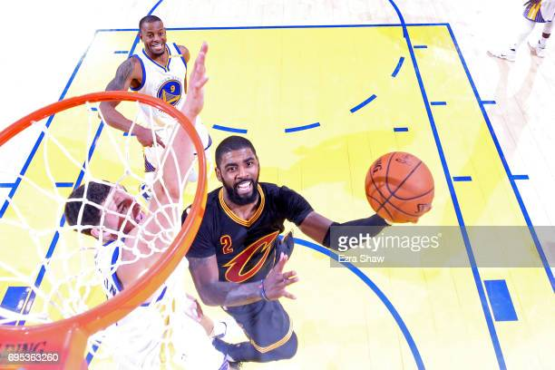 Kyrie Irving of the Cleveland Cavaliers attempts a lay up against the Golden State Warriors during the second half in Game 5 of the 2017 NBA Finals...