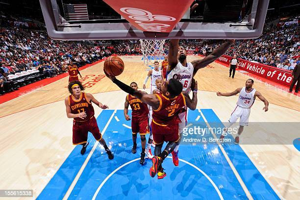 Kyrie Irving of the Cleveland Cavaliers attempts a reverse layup against DeAndre Jordan of the Los Angeles Clippers at Staples Center on November 5...