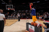 Kyrie Irving of the Cleveland Cavaliers attempts a shot during the 2013 Foot Locker ThreePoint Contest on State Farm AllStar Saturday Night as part...