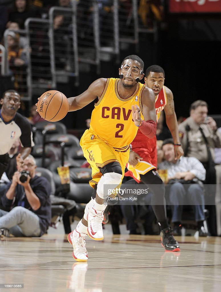 <a gi-track='captionPersonalityLinkClicked' href=/galleries/search?phrase=Kyrie+Irving&family=editorial&specificpeople=6893971 ng-click='$event.stopPropagation()'>Kyrie Irving</a> #2 of the Cleveland Cavaliers brings the ball up the court against the Houston Rockets at The Quicken Loans Arena on January 5, 2013 in Cleveland, Ohio.