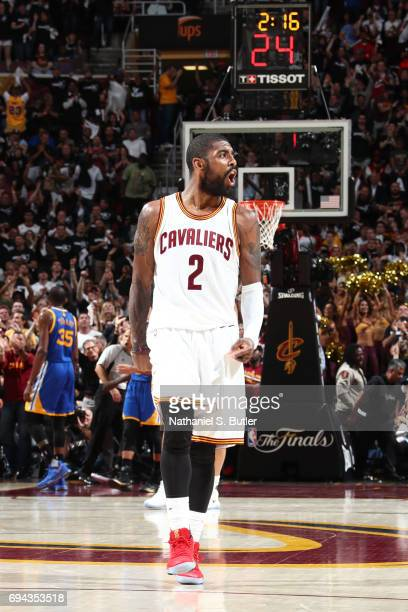 Kyrie Irving of the Cleveland Cavaliers celebrates a three point basket against the Golden State Warriors in Game Four of the 2017 NBA Finals on June...