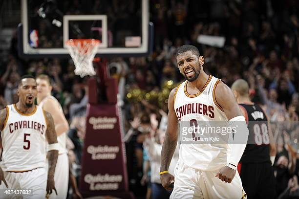 Kyrie Irving of the Cleveland Cavaliers celebrates during the game against the Portland Trail Blazers on January 28 2015 at Quicken Loans Arena in...