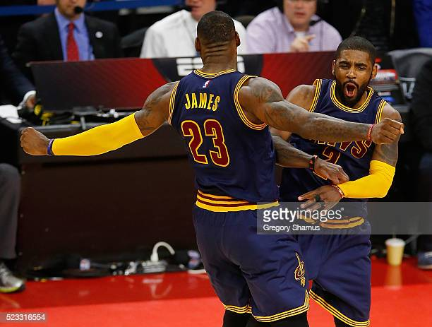Kyrie Irving of the Cleveland Cavaliers celebrates his late fourth quarter three pointer with LeBron James while playing the Detroit Pistons in game...