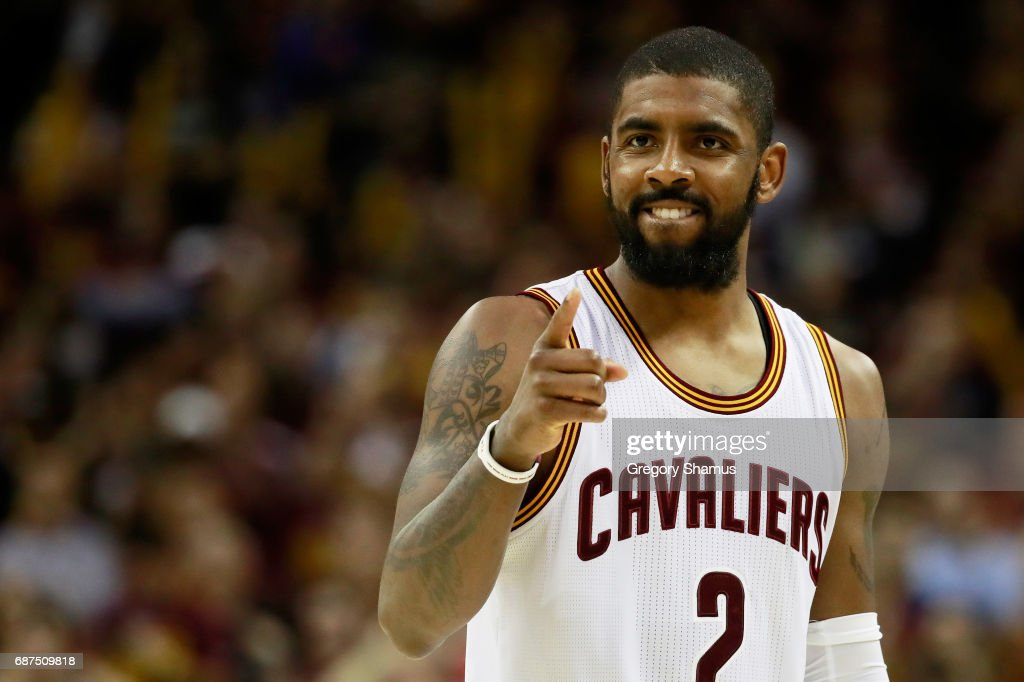 Kyrie Irving #2 of the Cleveland Cavaliers celebrates late in the fourth quarter of their 112 to 99 win over the Boston Celtics during Game Four of the 2017 NBA Eastern Conference Finals at Quicken Loans Arena on May 23, 2017 in Cleveland, Ohio.