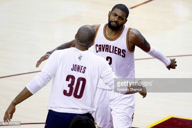 Kyrie Irving of the Cleveland Cavaliers celebrates with Dahntay Jones after a play in the fourth quarter against the Golden State Warriors in Game 4...