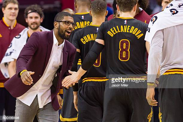 Kyrie Irving of the Cleveland Cavaliers celebrates with his teammates as they walk off the court during a timeout during the second half against the...