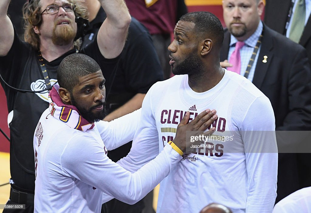 <a gi-track='captionPersonalityLinkClicked' href=/galleries/search?phrase=Kyrie+Irving&family=editorial&specificpeople=6893971 ng-click='$event.stopPropagation()'>Kyrie Irving</a> #2 of the Cleveland Cavaliers celebrates with <a gi-track='captionPersonalityLinkClicked' href=/galleries/search?phrase=LeBron+James&family=editorial&specificpeople=201474 ng-click='$event.stopPropagation()'>LeBron James</a> #23 after defeating the Golden State Warriors 120-90 in Game 3 of the 2016 NBA Finals at Quicken Loans Arena on June 8, 2016 in Cleveland, Ohio.