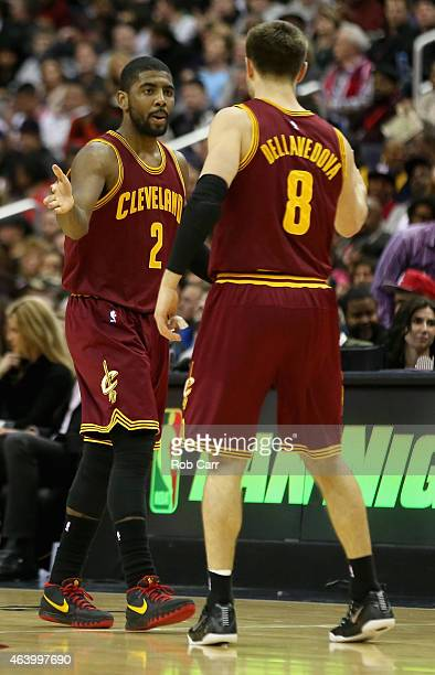 Kyrie Irving of the Cleveland Cavaliers celebrates with Matthew Dellavedova after scoring during the second half of their 12889 win over the...