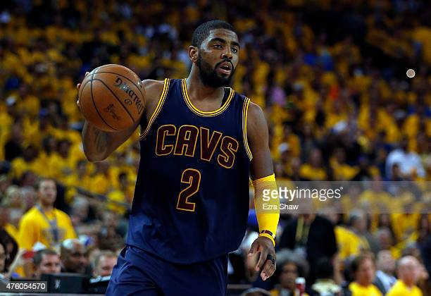 Kyrie Irving of the Cleveland Cavaliers controls the ball against the Golden State Warriors during Game One of the 2015 NBA Finals at ORACLE Arena on...