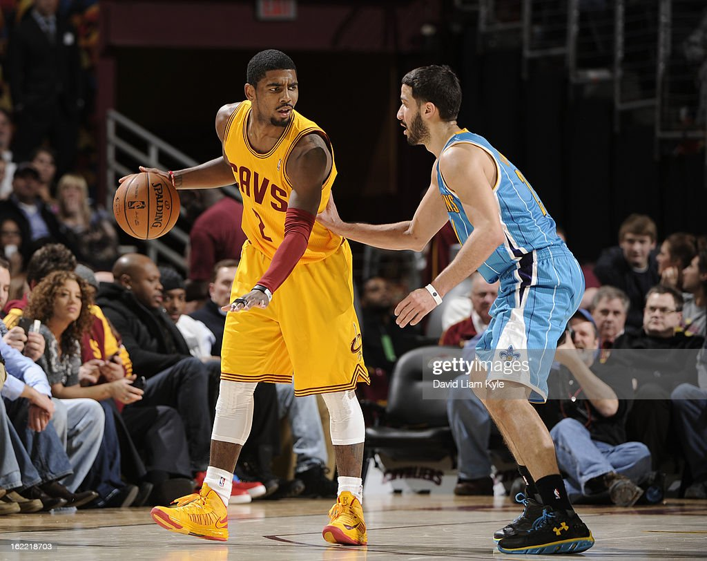 <a gi-track='captionPersonalityLinkClicked' href=/galleries/search?phrase=Kyrie+Irving&family=editorial&specificpeople=6893971 ng-click='$event.stopPropagation()'>Kyrie Irving</a> #2 of the Cleveland Cavaliers controls the ball while guarded by <a gi-track='captionPersonalityLinkClicked' href=/galleries/search?phrase=Greivis+Vasquez&family=editorial&specificpeople=4066977 ng-click='$event.stopPropagation()'>Greivis Vasquez</a> #21 of the New Orleans Hornets at The Quicken Loans Arena on February 20, 2013 in Cleveland, Ohio.