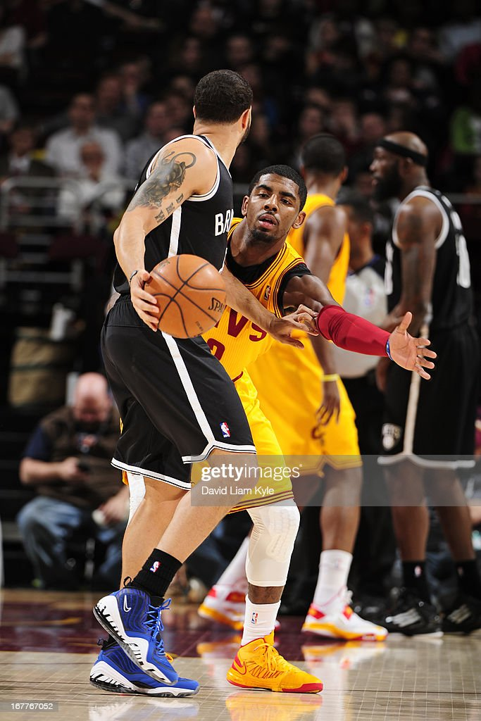 <a gi-track='captionPersonalityLinkClicked' href=/galleries/search?phrase=Kyrie+Irving&family=editorial&specificpeople=6893971 ng-click='$event.stopPropagation()'>Kyrie Irving</a> #2 of the Cleveland Cavaliers defends against <a gi-track='captionPersonalityLinkClicked' href=/galleries/search?phrase=Deron+Williams&family=editorial&specificpeople=203215 ng-click='$event.stopPropagation()'>Deron Williams</a> #8 of the Brooklyn Nets at The Quicken Loans Arena on April 3, 2013 in Cleveland, Ohio.