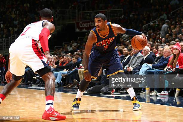 Kyrie Irving of the Cleveland Cavaliers defends the ball against the Washington Wizards during the game on January 6 2016 at Verizon Center in...