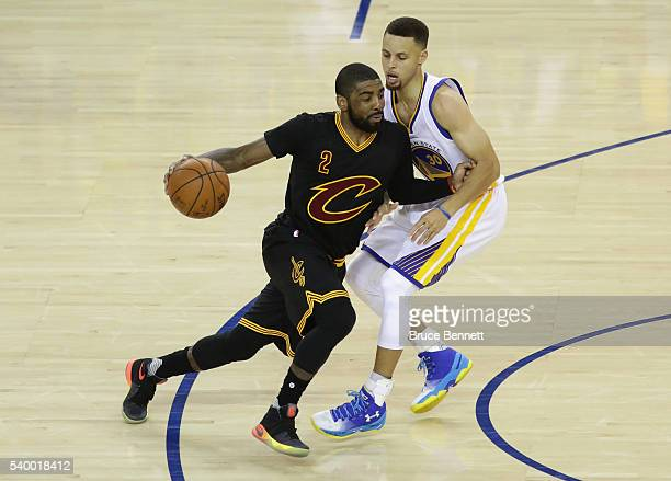 Kyrie Irving of the Cleveland Cavaliers dribbles against Stephen Curry of the Golden State Warriors during the second half in Game 5 of the 2016 NBA...