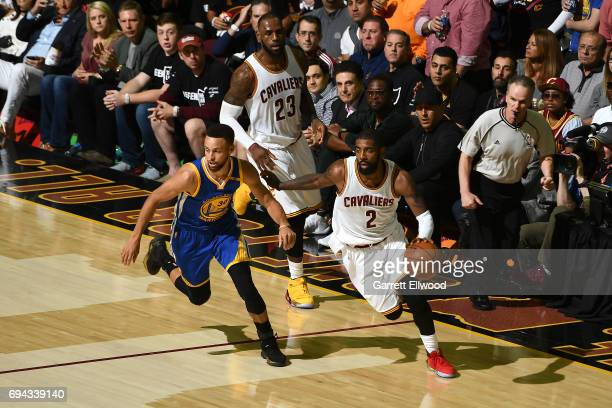 Kyrie Irving of the Cleveland Cavaliers dribbles the ball against Stephen Curry of the Golden State Warriors in Game Four of the 2017 NBA Finals on...
