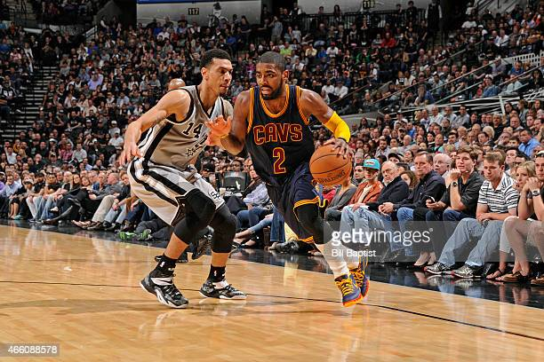 Kyrie Irving of the Cleveland Cavaliers dribbles the ball against the San Antonio Spurs on March 12 2015 at the ATT Center in San Antonio Texas NOTE...