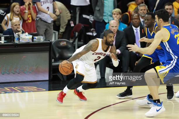 Kyrie Irving of the Cleveland Cavaliers dribbles the ball against the Golden State Warriors in Game Four of the 2017 NBA Finals on June 9 2017 at...