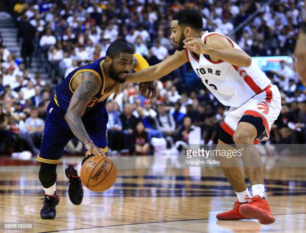 Kyrie Irving of the Cleveland Cavaliers dribbles the ball as Cory Joseph of the Toronto Raptors defends in the first half of Game Four of the Eastern...