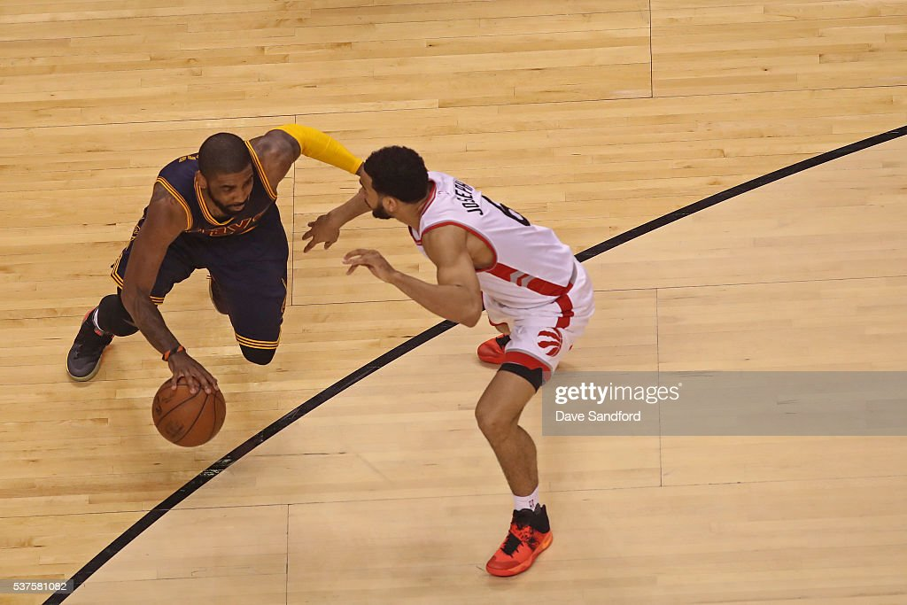 <a gi-track='captionPersonalityLinkClicked' href=/galleries/search?phrase=Kyrie+Irving&family=editorial&specificpeople=6893971 ng-click='$event.stopPropagation()'>Kyrie Irving</a> #2 of the Cleveland Cavaliers dribbles the ball while guarded by <a gi-track='captionPersonalityLinkClicked' href=/galleries/search?phrase=Cory+Joseph&family=editorial&specificpeople=5953537 ng-click='$event.stopPropagation()'>Cory Joseph</a> #6 of the Toronto Raptors in Game Six of the NBA Eastern Conference Finals at Air Canada Centre on May 27, 2016 in Toronto, Ontario, Canada.