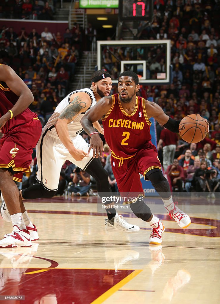 <a gi-track='captionPersonalityLinkClicked' href=/galleries/search?phrase=Kyrie+Irving&family=editorial&specificpeople=6893971 ng-click='$event.stopPropagation()'>Kyrie Irving</a> #2 of the Cleveland Cavaliers drives against <a gi-track='captionPersonalityLinkClicked' href=/galleries/search?phrase=Deron+Williams&family=editorial&specificpeople=203215 ng-click='$event.stopPropagation()'>Deron Williams</a> #8 of the Brooklyn Nets during a game at the Quicken Loans Arena on October 30, 2013 in Cleveland, Ohio.