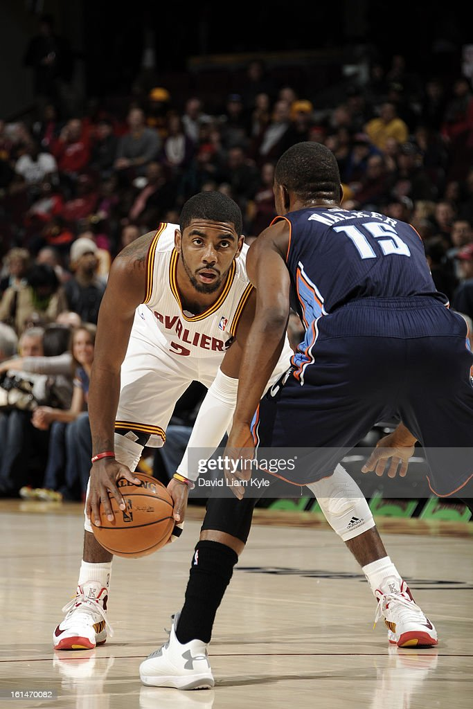 <a gi-track='captionPersonalityLinkClicked' href=/galleries/search?phrase=Kyrie+Irving&family=editorial&specificpeople=6893971 ng-click='$event.stopPropagation()'>Kyrie Irving</a> #2 of the Cleveland Cavaliers drives against Kemba Walker #15 of the Charlotte Bobcats at The Quicken Loans Arena on February 6, 2013 in Cleveland, Ohio.