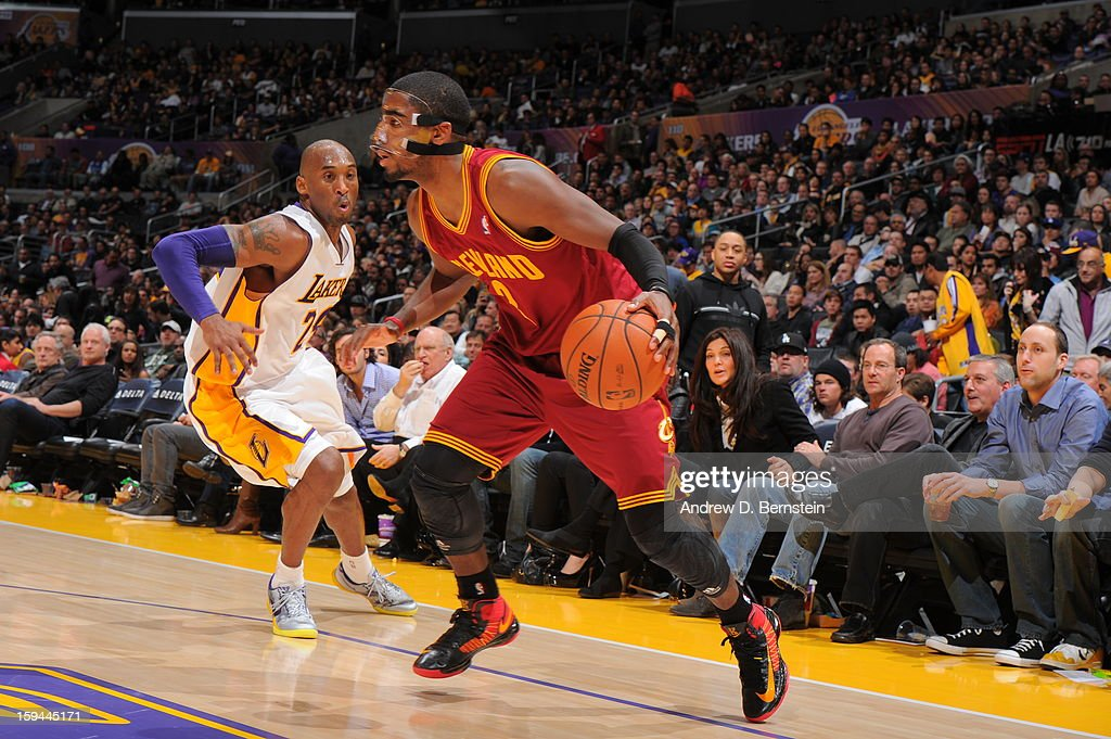 Kyrie Irving #2 of the Cleveland Cavaliers drives against Kobe Bryant #24 of the Los Angeles Lakers at Staples Center on January 13, 2013 in Los Angeles, California.