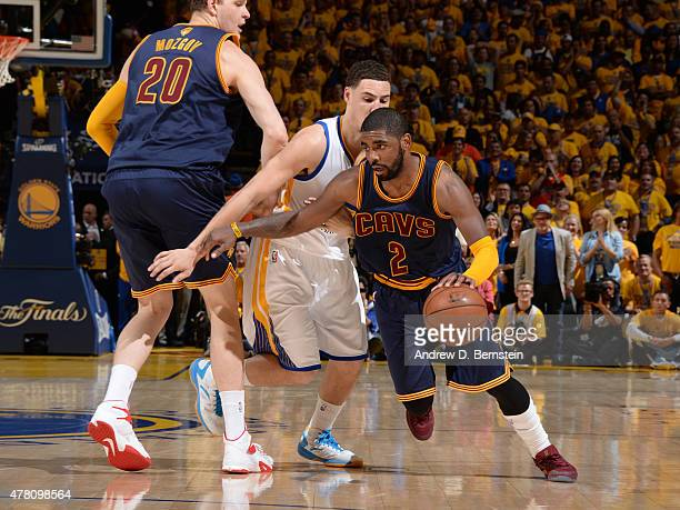Kyrie Irving of the Cleveland Cavaliers drives against the Golden State Warriors in Game One of the 2015 NBA Finals on June 4 2015 at Oracle Arena in...