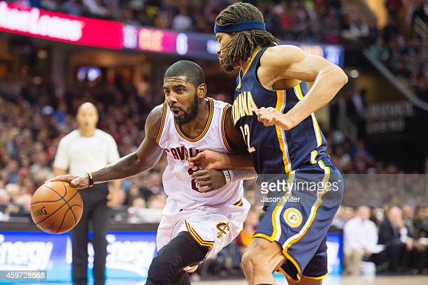 Kyrie Irving of the Cleveland Cavaliers drives past Chris Copeland of the Indiana Pacers during the second half at Quicken Loans Arena on November 29...