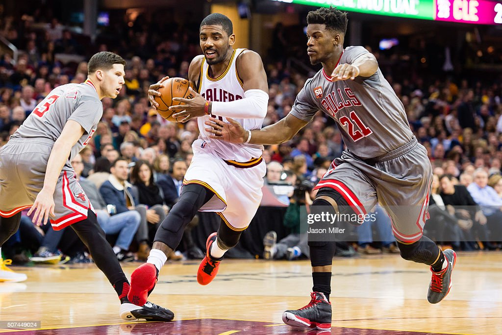 <a gi-track='captionPersonalityLinkClicked' href=/galleries/search?phrase=Kyrie+Irving&family=editorial&specificpeople=6893971 ng-click='$event.stopPropagation()'>Kyrie Irving</a> #2 of the Cleveland Cavaliers drives through <a gi-track='captionPersonalityLinkClicked' href=/galleries/search?phrase=Doug+McDermott&family=editorial&specificpeople=7544468 ng-click='$event.stopPropagation()'>Doug McDermott</a> #3 of the Chicago Bulls and <a gi-track='captionPersonalityLinkClicked' href=/galleries/search?phrase=Jimmy+Butler+-+Basketbalspeler&family=editorial&specificpeople=9860567 ng-click='$event.stopPropagation()'>Jimmy Butler</a> #21 during the first half at Quicken Loans Arena on January 23, 2016 in Cleveland, Ohio.