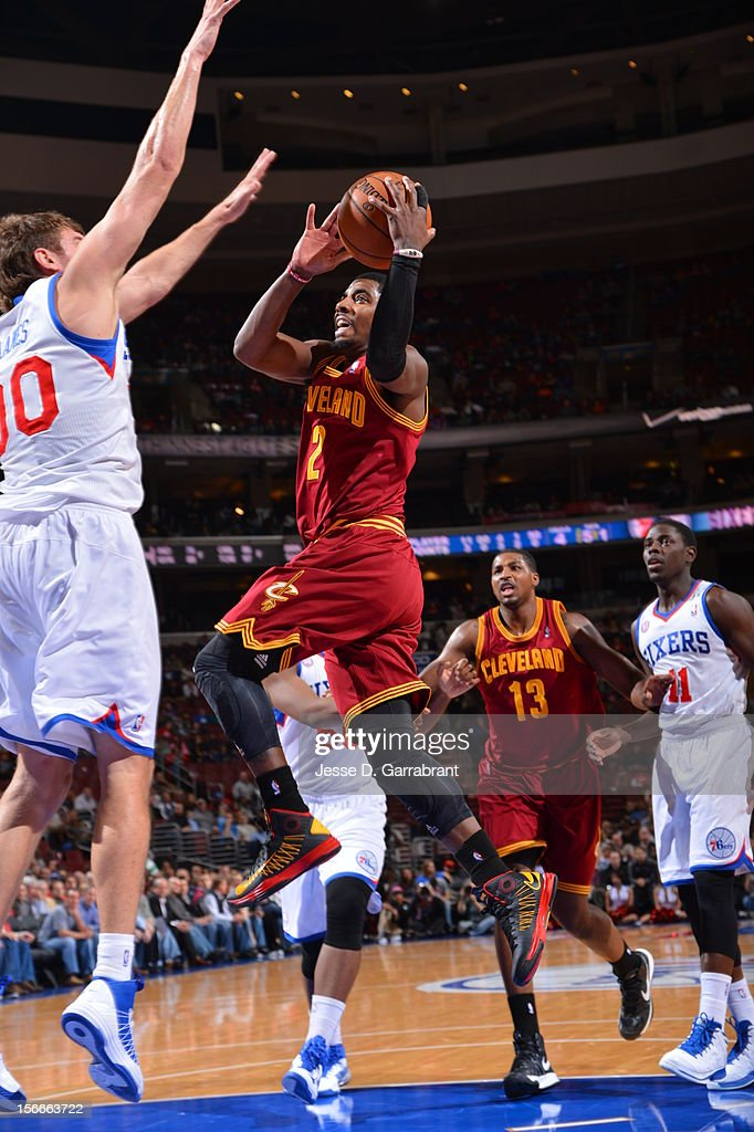 Kyrie Irving #2 of the Cleveland Cavaliers drives to the basket against Spencer Hawes #00 of the Philadelphia 76ers at the Wells Fargo Center on November 18, 2012 in Philadelphia, Pennsylvania.
