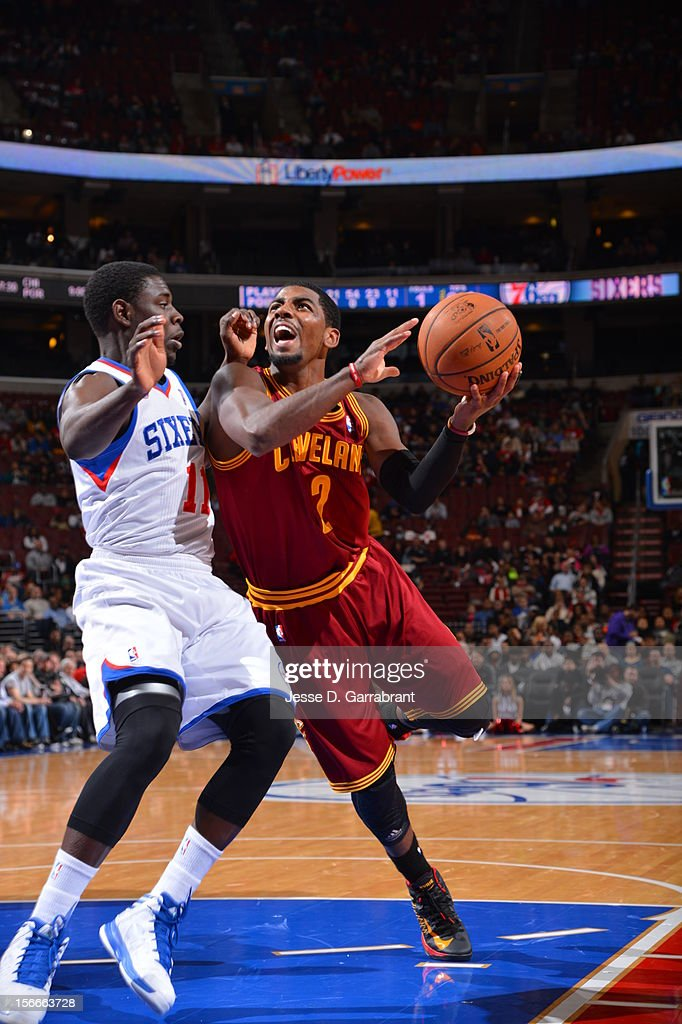 Kyrie Irving #2 of the Cleveland Cavaliers drives to the basket against Jrue Holiday #11 of the Philadelphia 76ers at the Wells Fargo Center on November 18, 2012 in Philadelphia, Pennsylvania.