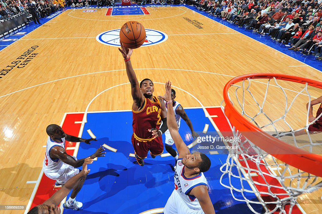 Kyrie Irving #2 of the Cleveland Cavaliers drives to the basket against Evan Turner #12 of the Philadelphia 76ers at the Wells Fargo Center on November 18, 2012 in Philadelphia, Pennsylvania.