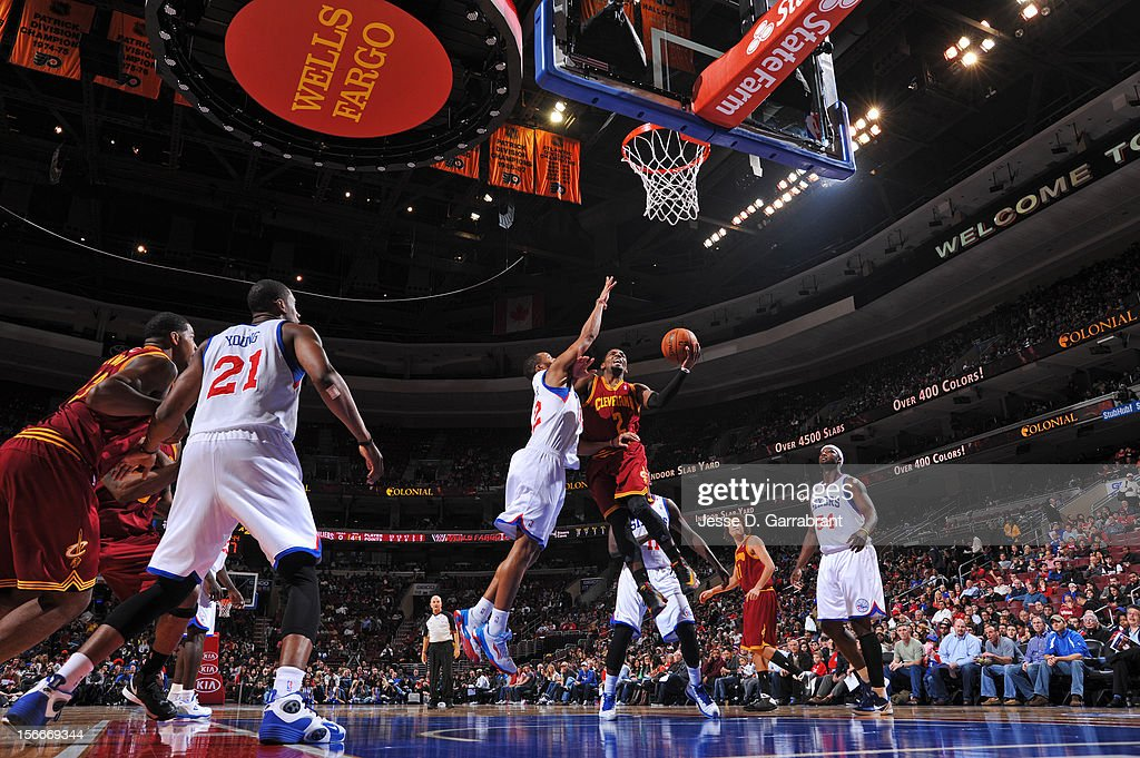 <a gi-track='captionPersonalityLinkClicked' href=/galleries/search?phrase=Kyrie+Irving&family=editorial&specificpeople=6893971 ng-click='$event.stopPropagation()'>Kyrie Irving</a> #2 of the Cleveland Cavaliers drives to the basket against <a gi-track='captionPersonalityLinkClicked' href=/galleries/search?phrase=Evan+Turner&family=editorial&specificpeople=4665764 ng-click='$event.stopPropagation()'>Evan Turner</a> #12 of the Philadelphia 76ers at the Wells Fargo Center on November 18, 2012 in Philadelphia, Pennsylvania.