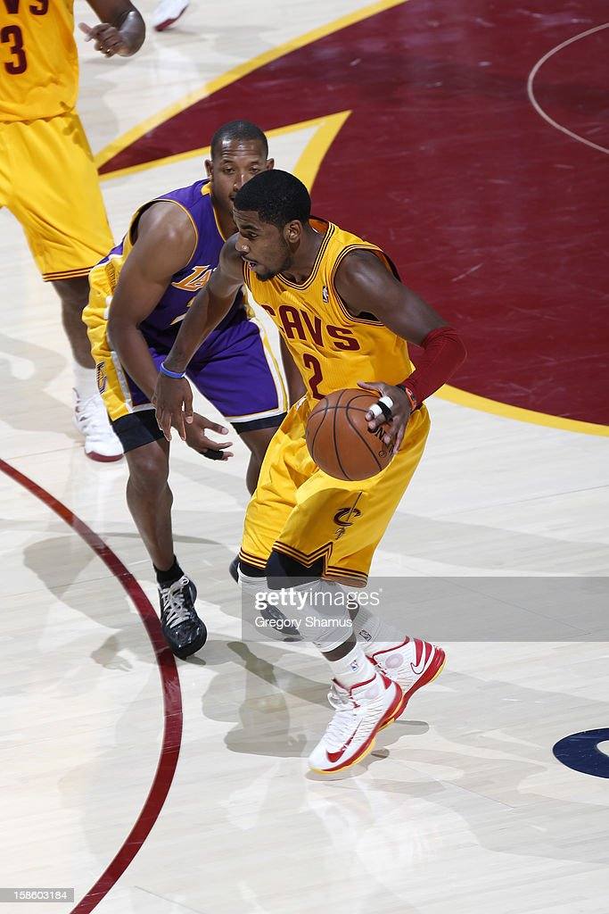 <a gi-track='captionPersonalityLinkClicked' href=/galleries/search?phrase=Kyrie+Irving&family=editorial&specificpeople=6893971 ng-click='$event.stopPropagation()'>Kyrie Irving</a> #2 of the Cleveland Cavaliers drives to the basket against the Los Angeles Lakers at The Quicken Loans Arena on December 11, 2012 in Cleveland, Ohio.