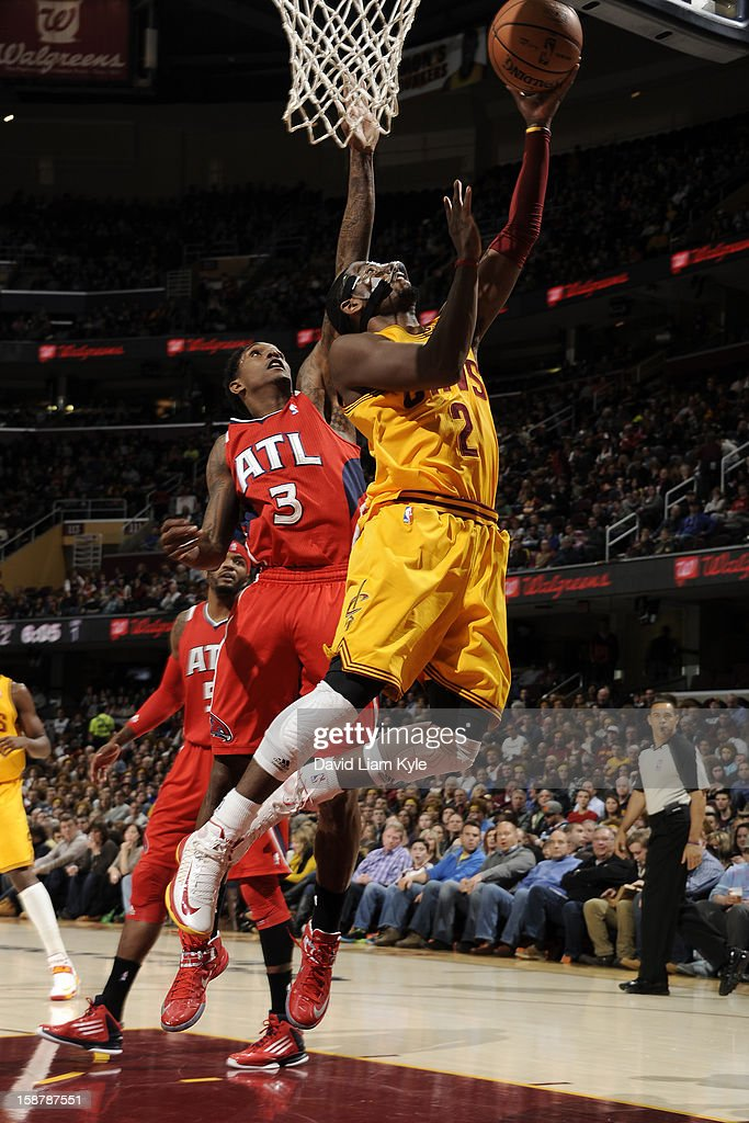 Kyrie Irving #2 of the Cleveland Cavaliers drives to the basket against Louis Williams #3 of the Atlanta Hawks at The Quicken Loans Arena on December 28, 2012 in Cleveland, Ohio.