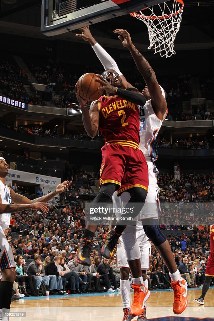 <a gi-track='captionPersonalityLinkClicked' href=/galleries/search?phrase=Kyrie+Irving&family=editorial&specificpeople=6893971 ng-click='$event.stopPropagation()'>Kyrie Irving</a> #2 of the Cleveland Cavaliers drives to the basket against the Charlotte Bobcats at the Time Warner Cable Arena on January 4, 2013 in Charlotte, North Carolina.
