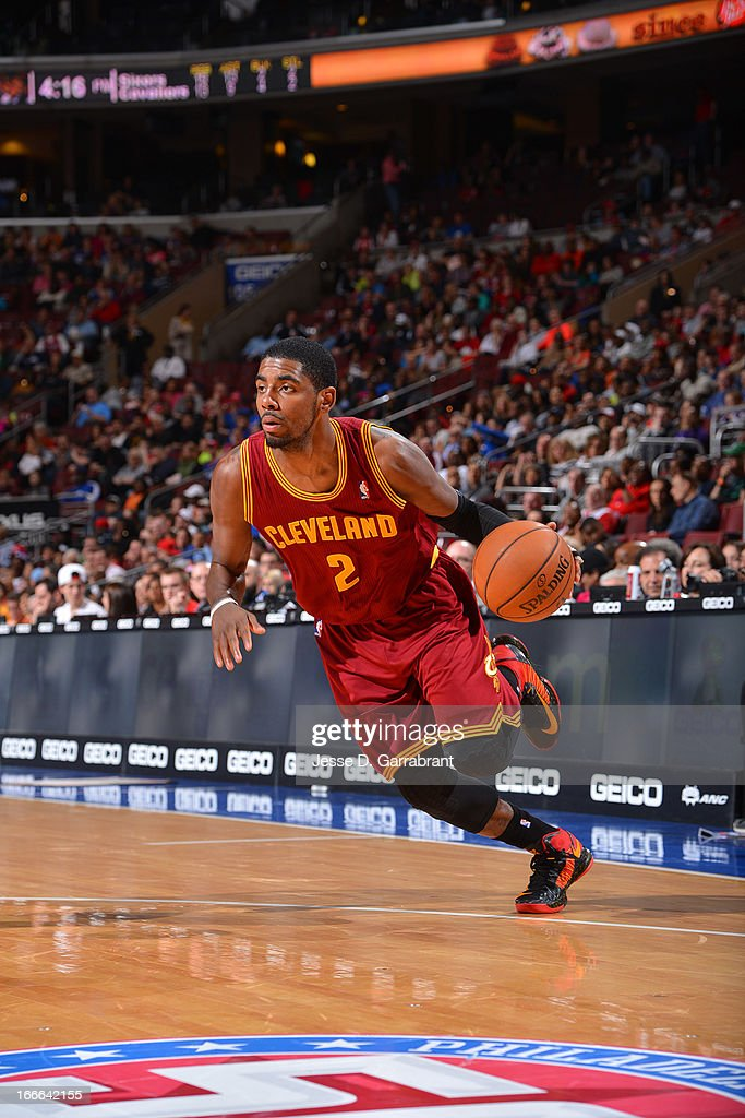 <a gi-track='captionPersonalityLinkClicked' href=/galleries/search?phrase=Kyrie+Irving&family=editorial&specificpeople=6893971 ng-click='$event.stopPropagation()'>Kyrie Irving</a> #2 of the Cleveland Cavaliers drives to the basket against the Philadelphia 76ers at the Wells Fargo Center on April 14, 2013 in Philadelphia, Pennsylvania.